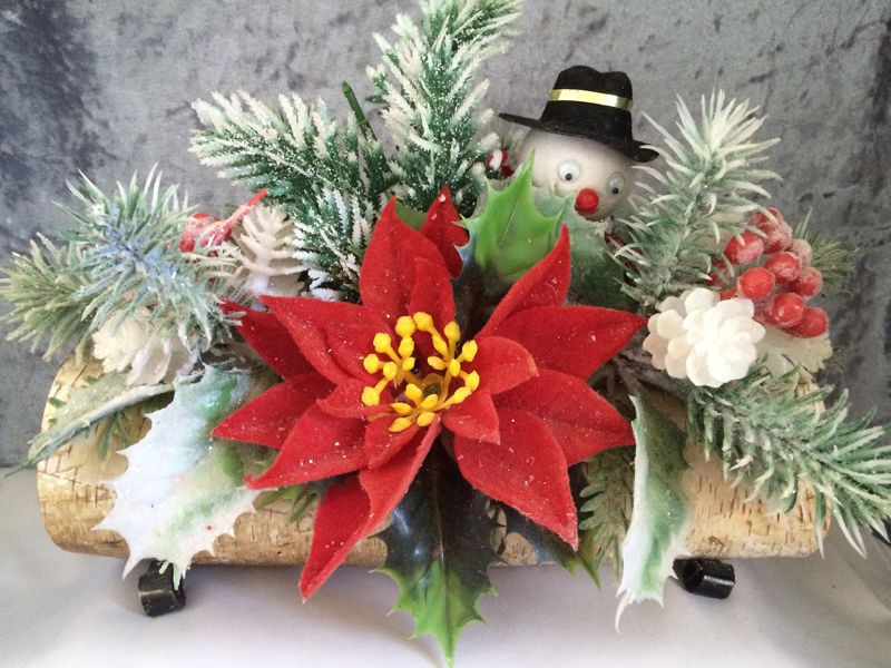 1960s 1970s vintage plastic flower christmas centerpiece with google eyed snowman on a birch yule log