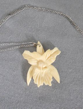 1960s Vintage Signed Hand Carved Faux Ivory Orchid Flower Pendant Necklace in necklaces and pendants
